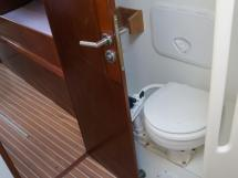 AYC Yachtbroker - JFA 45 Deck Saloon - Forward bathroom's toilet